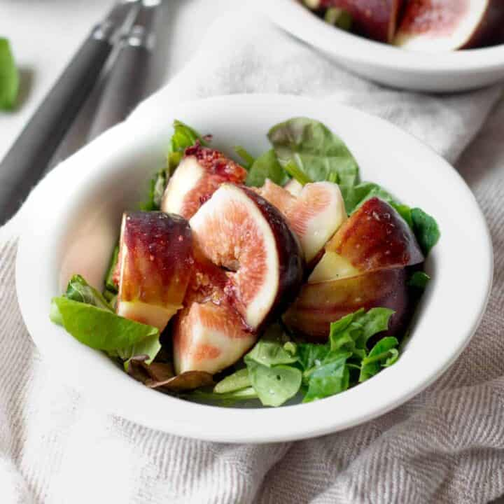 simple fig salad in a bowl with two folks