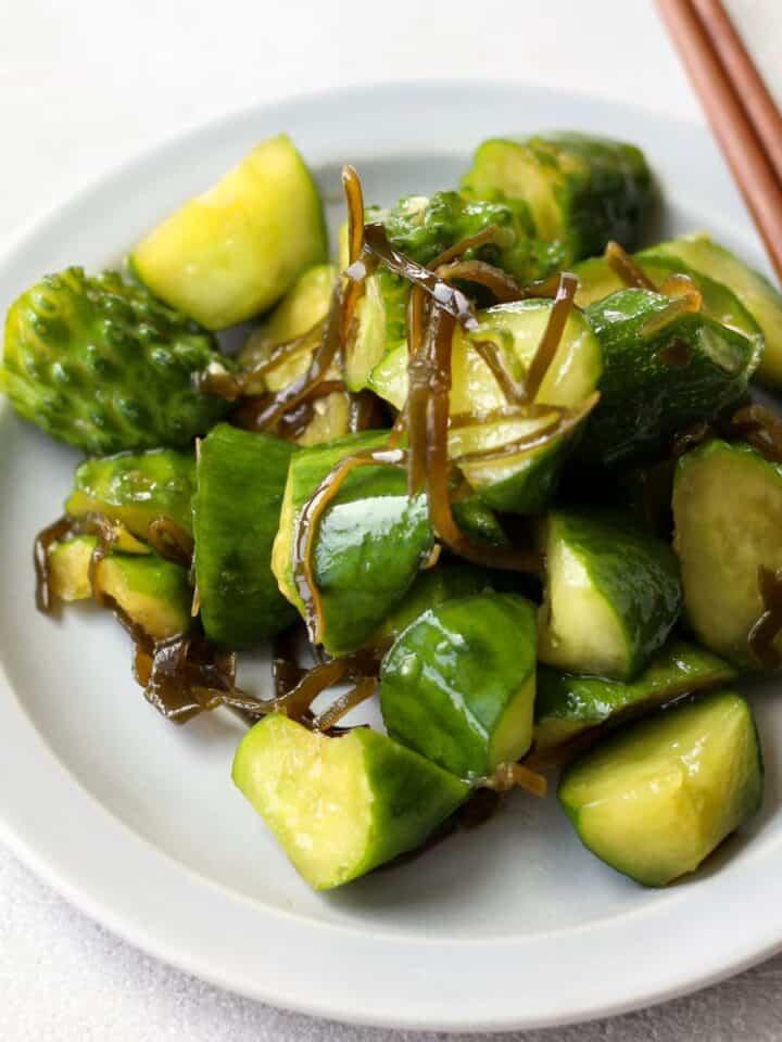 Cucumber asazuke on a plate with chopsticks