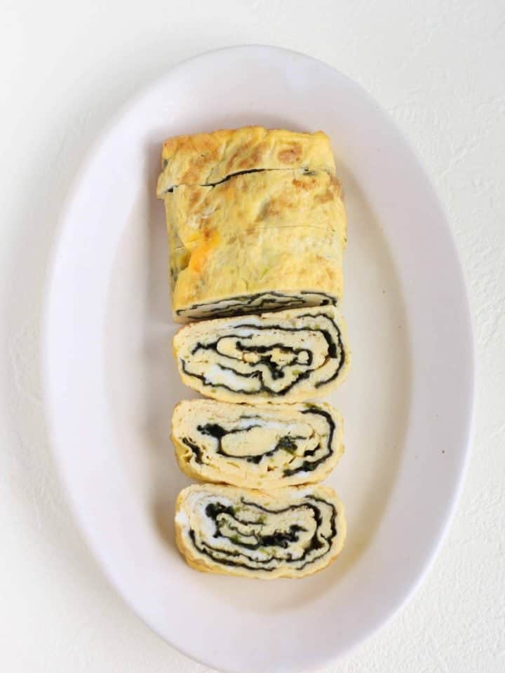 Tamagoyaki (Japanese Rolled Egg) recipe using Nori sheet. Tamagoyaki is easy and tasty Japanese everyday dish. Just roll Nori sheet together with egg, it will make a special looking tamagoyaki.