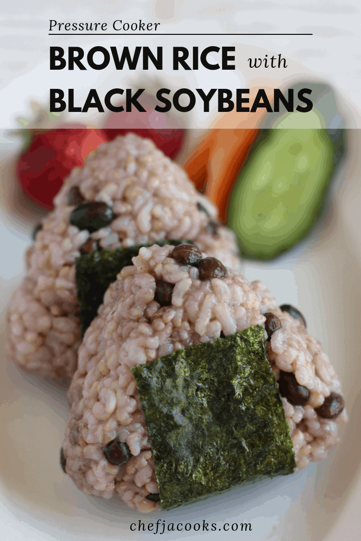 Onigiri(rice ball) of brown rice with black soybeans on a plate. Photo taken from an angle.