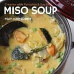 Pumpkin miso soup in a pot. In the soup, plenty of vegetable like pumpkin, peas, chinese cabbage etc.