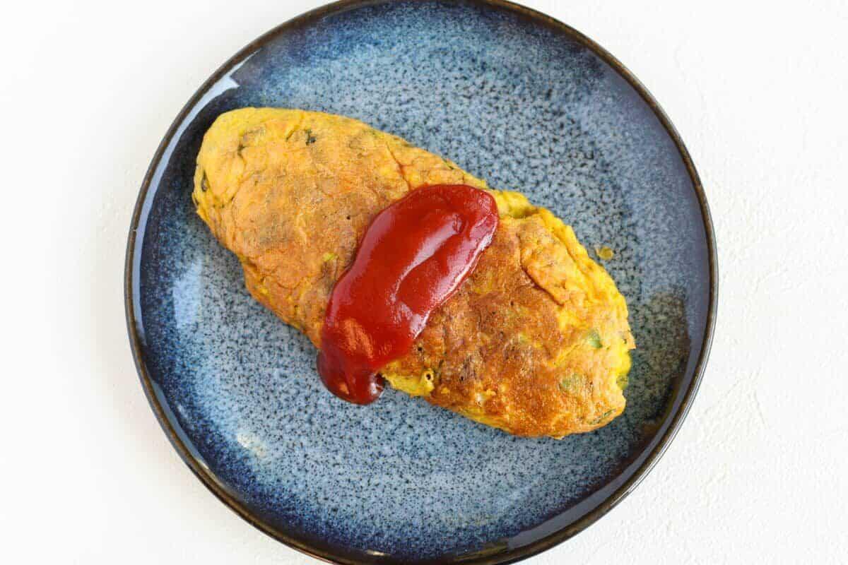 avocado omelet on a dark blue plate