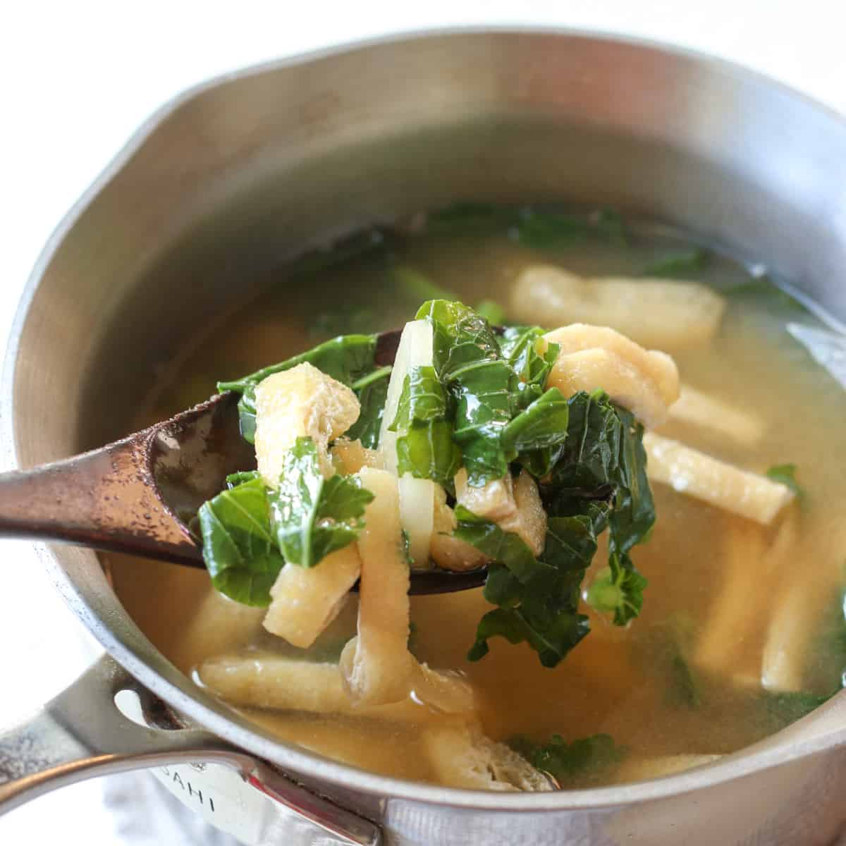daikon miso soup in a pot with spoon