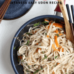 Yaki udon noodles on a blue plate. Ingredients are carrots, green peppers, tuna and bonito.