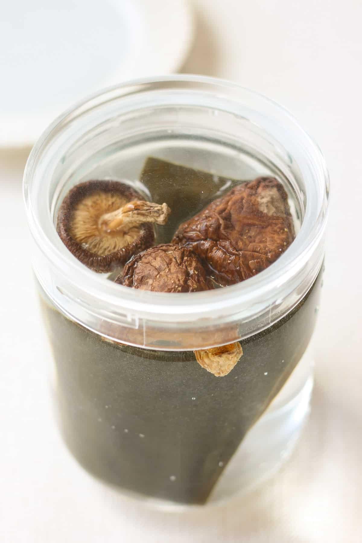 dried shiitake, kombu and water in a bottle for making dashi