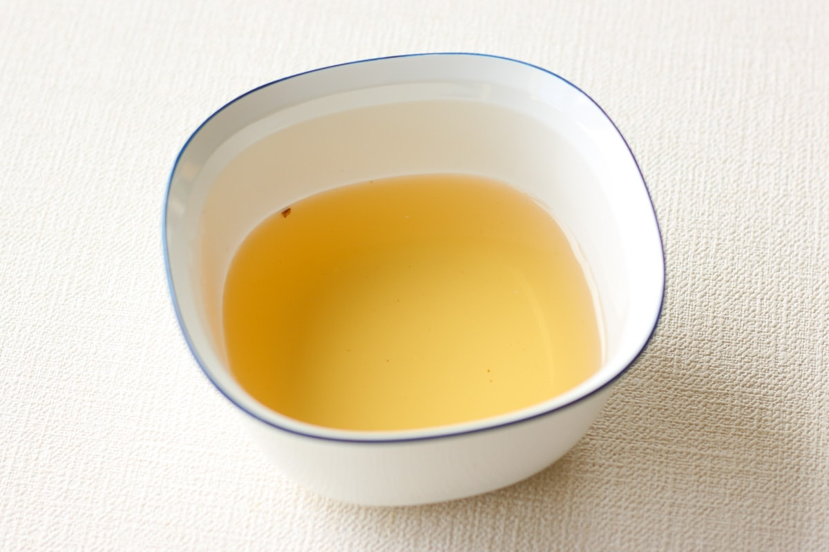 gold brown color shiitake kombu dashi in a bowl