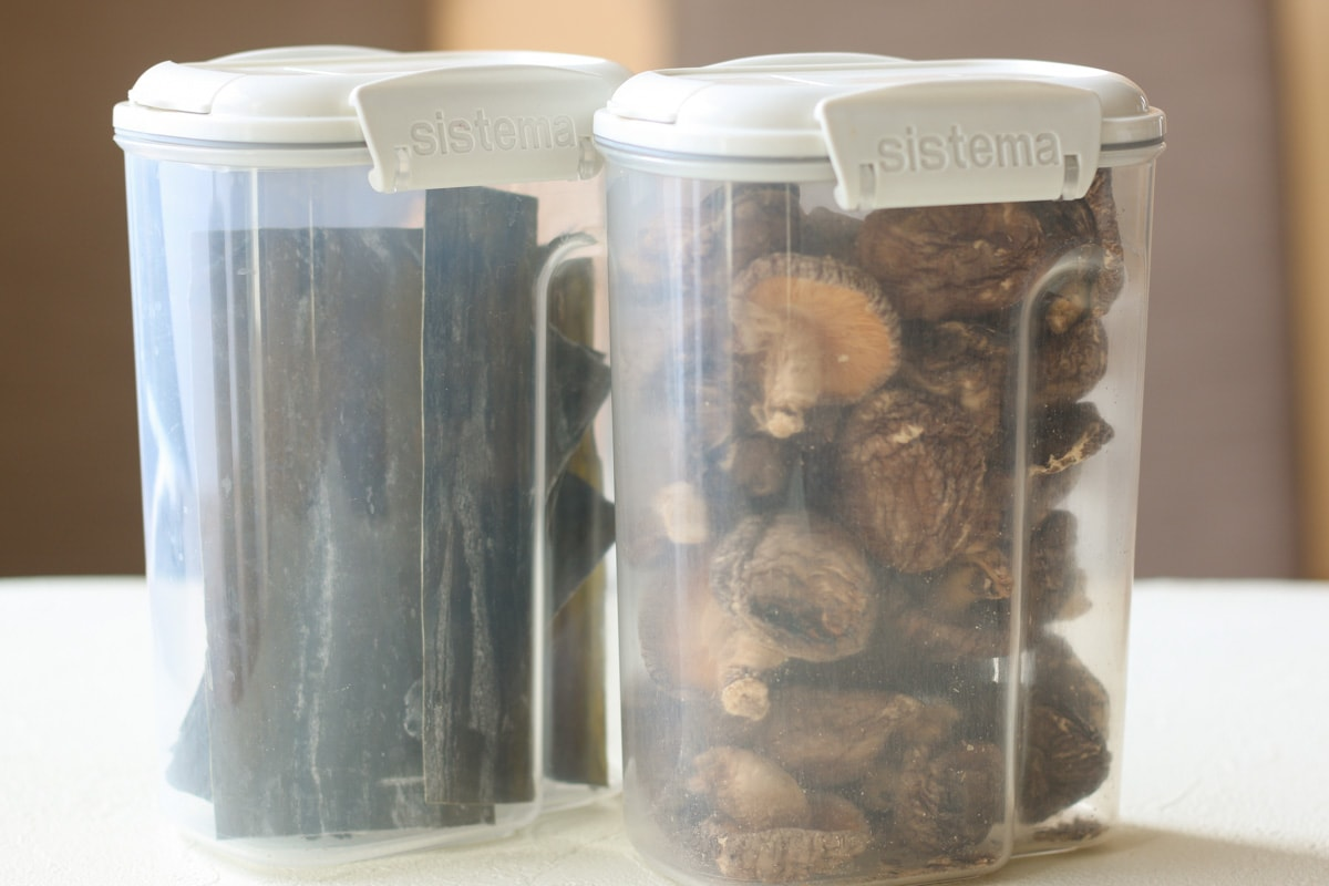 dried shiitake and kombu in a plastic container
