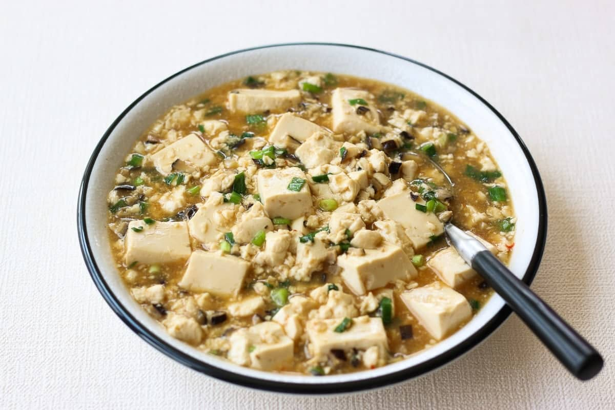 Japanese mapo tofu served on a white plate