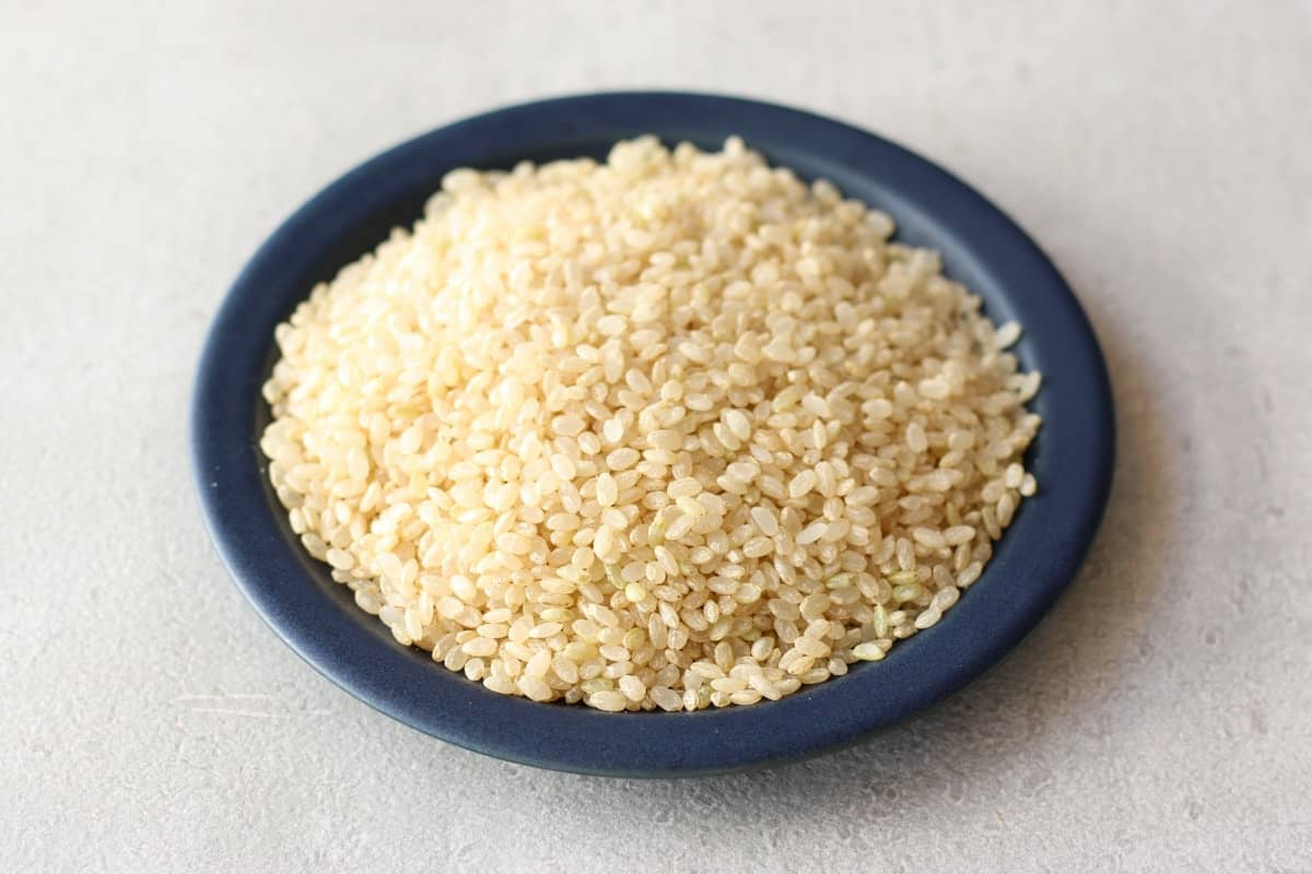 Japanese brown rice (raw) on a plate