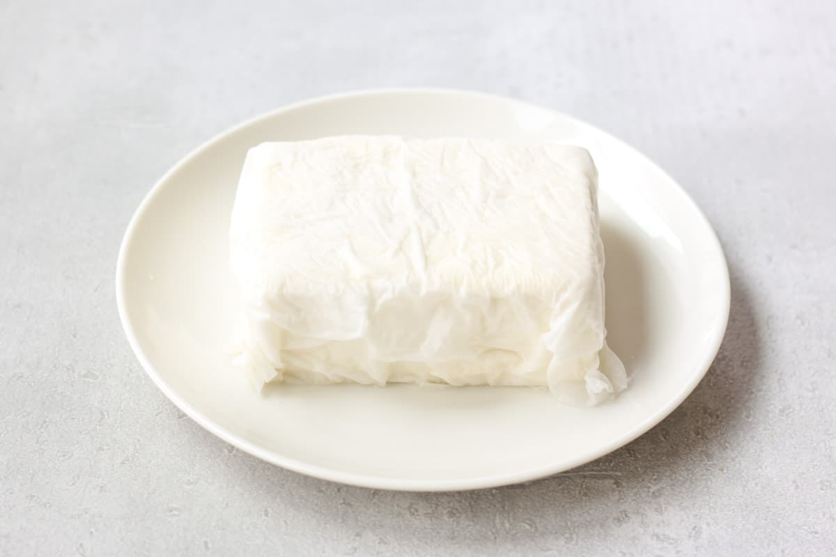 tofu wrapped up with paper towels
