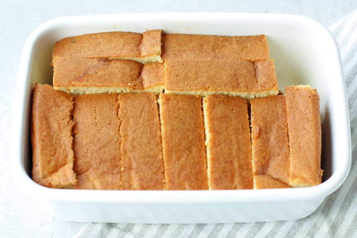 many slices of Japanese castella cake in a container