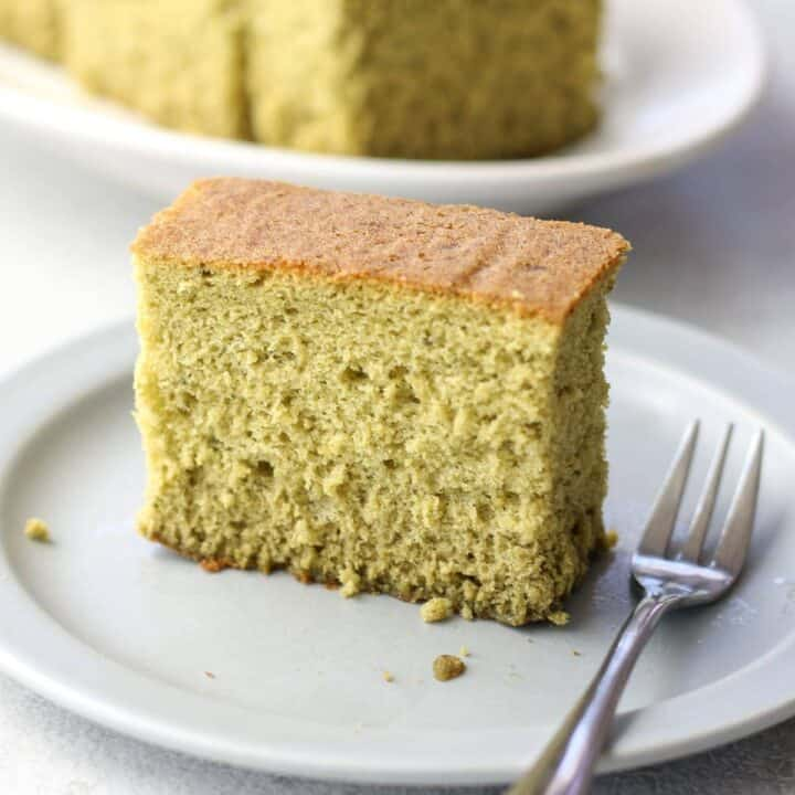 a slice of matcha castella on a plate with a folk