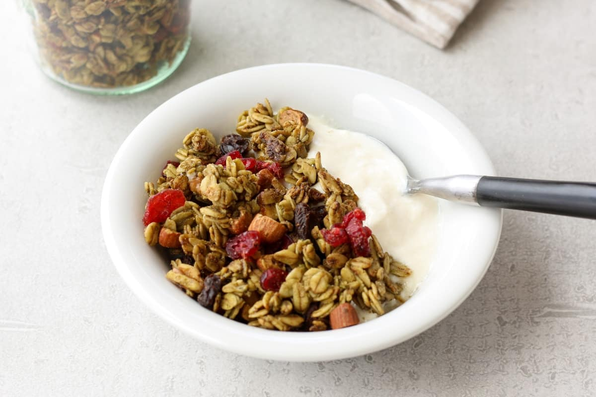 matcha granola over yogurt in a bowl