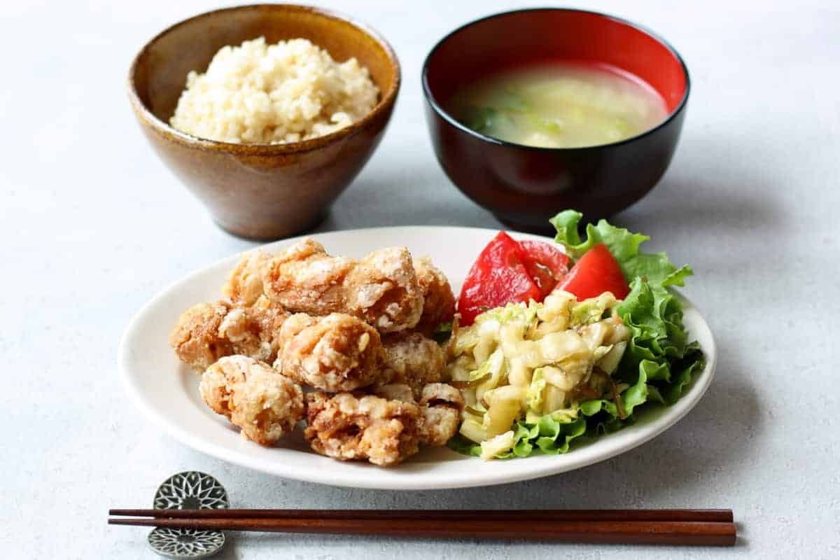 a Japanese meal - stemaed rice, miso soup, and vegan karaage