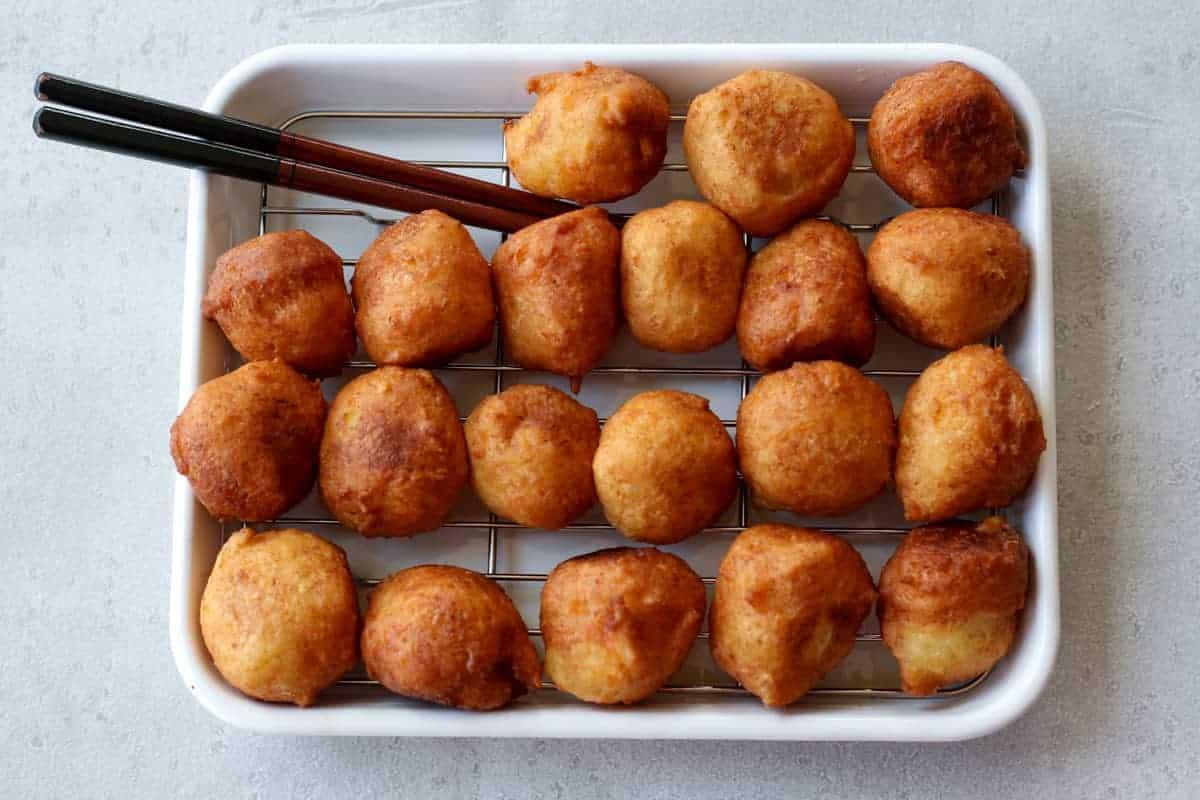 many tofu donut balls on a tray