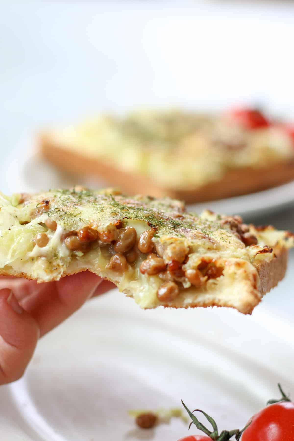 bite shot of natto cheese toast
