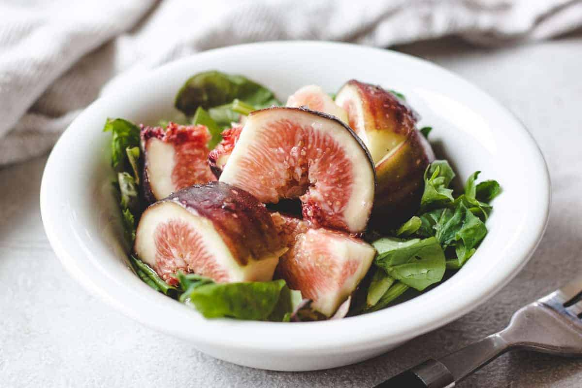 simple fig salad in a bowl with a folk